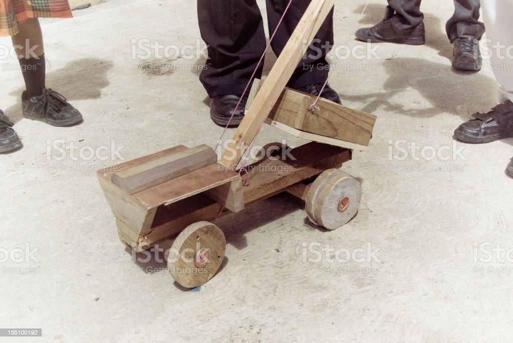 kids playing with toy wooden vehicle; traditional creole culture royalty-free stock photo