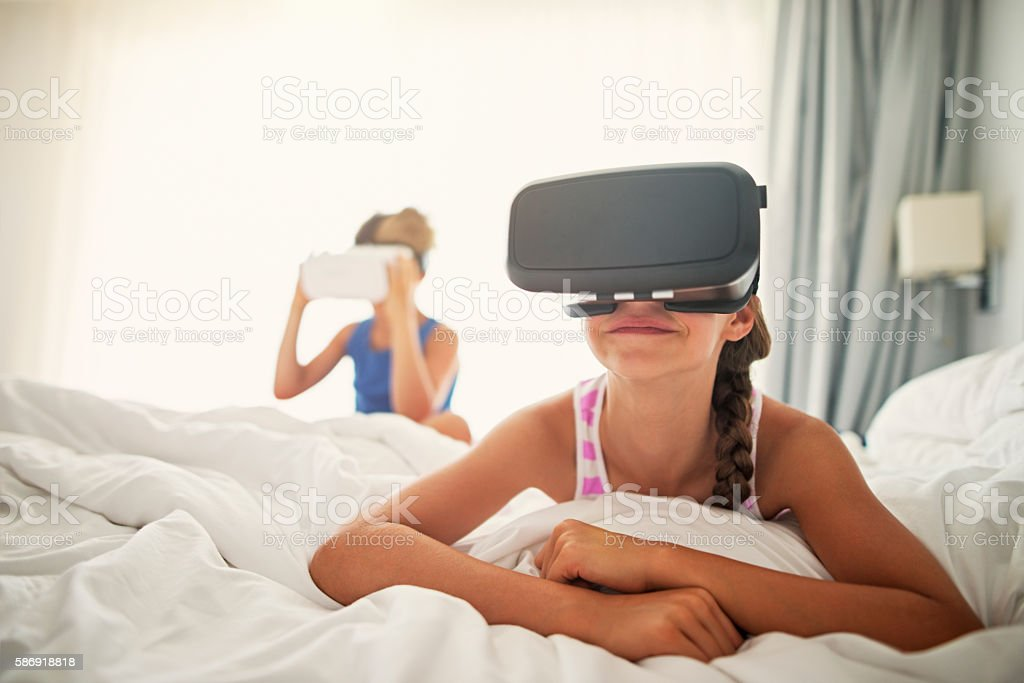 Kids playing with virtual reality headset stock photo
