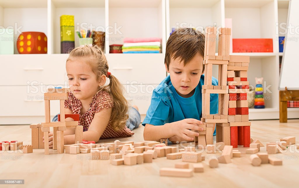 Kids playing with wooden blocks royalty-free stock photo