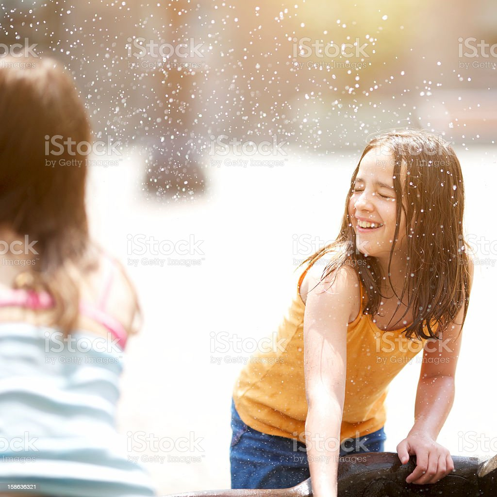Kids plays with water royalty-free stock photo