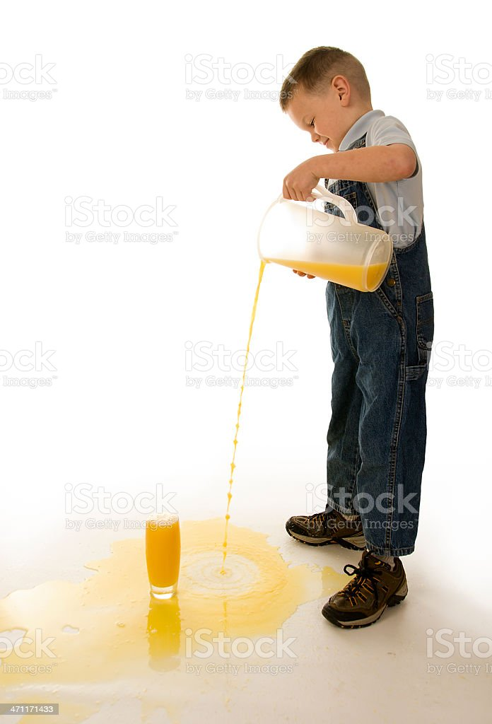 Kids pouring and spilling juice on the floor royalty-free stock photo
