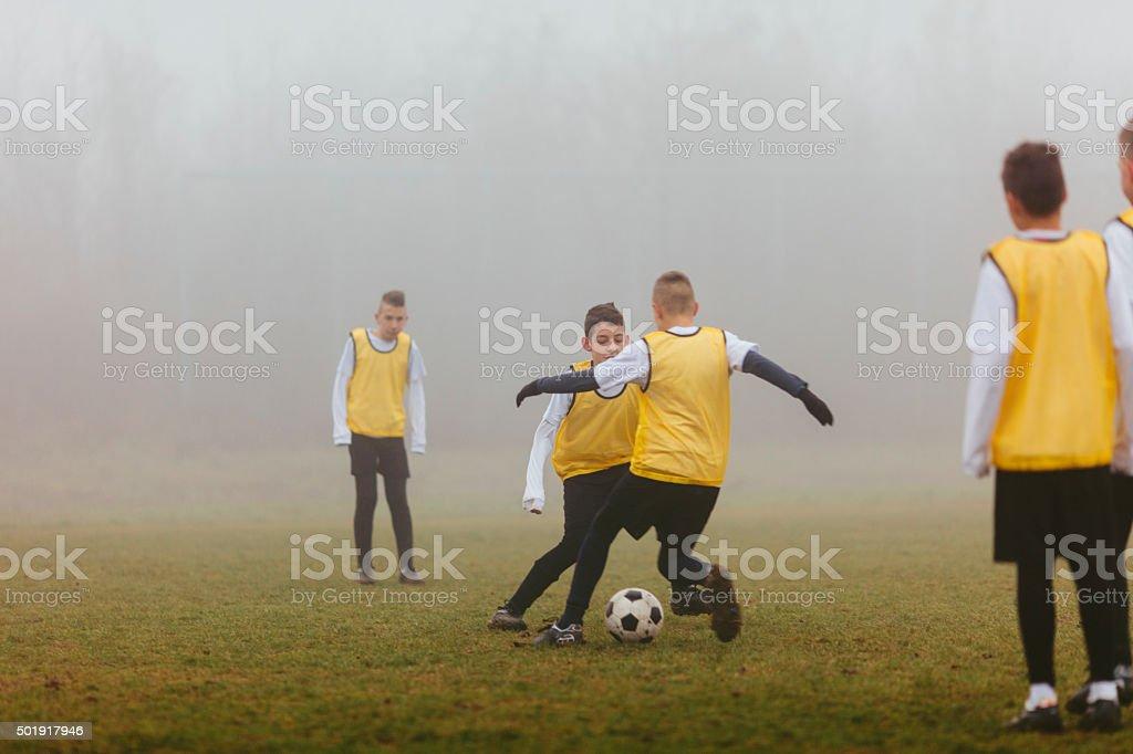 Kids Practicing Dribbling At Soccer Training. stock photo