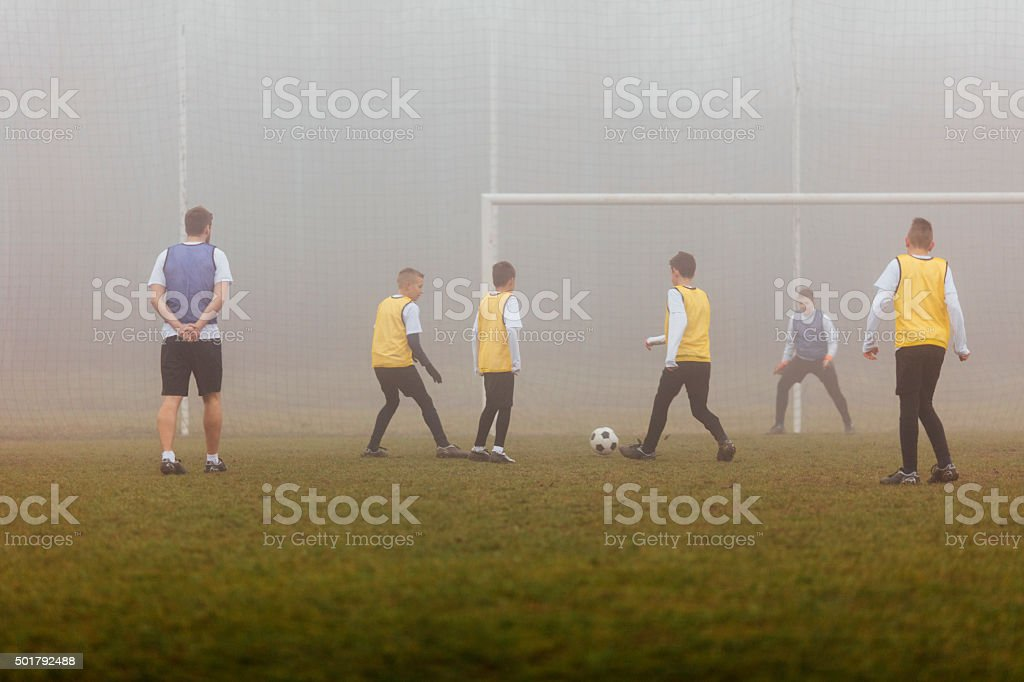 Kids Practicing Strategy At Soccer Training. stock photo