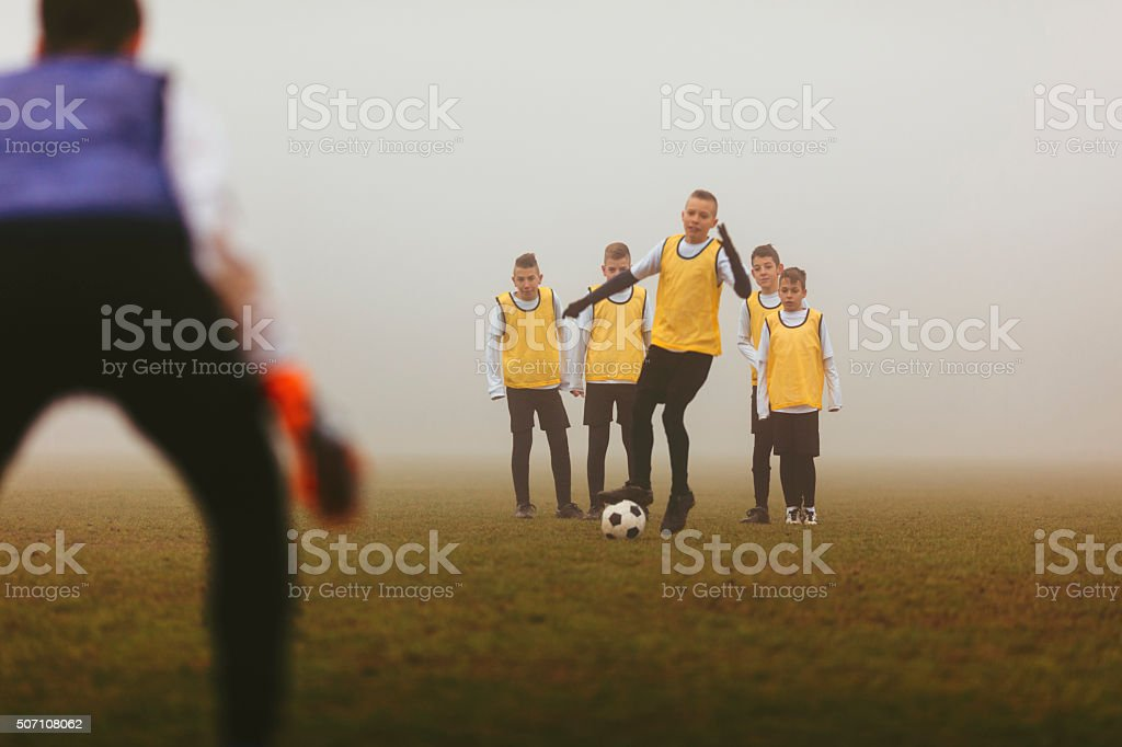 Kids Practicing Strategy At Soccer Training stock photo