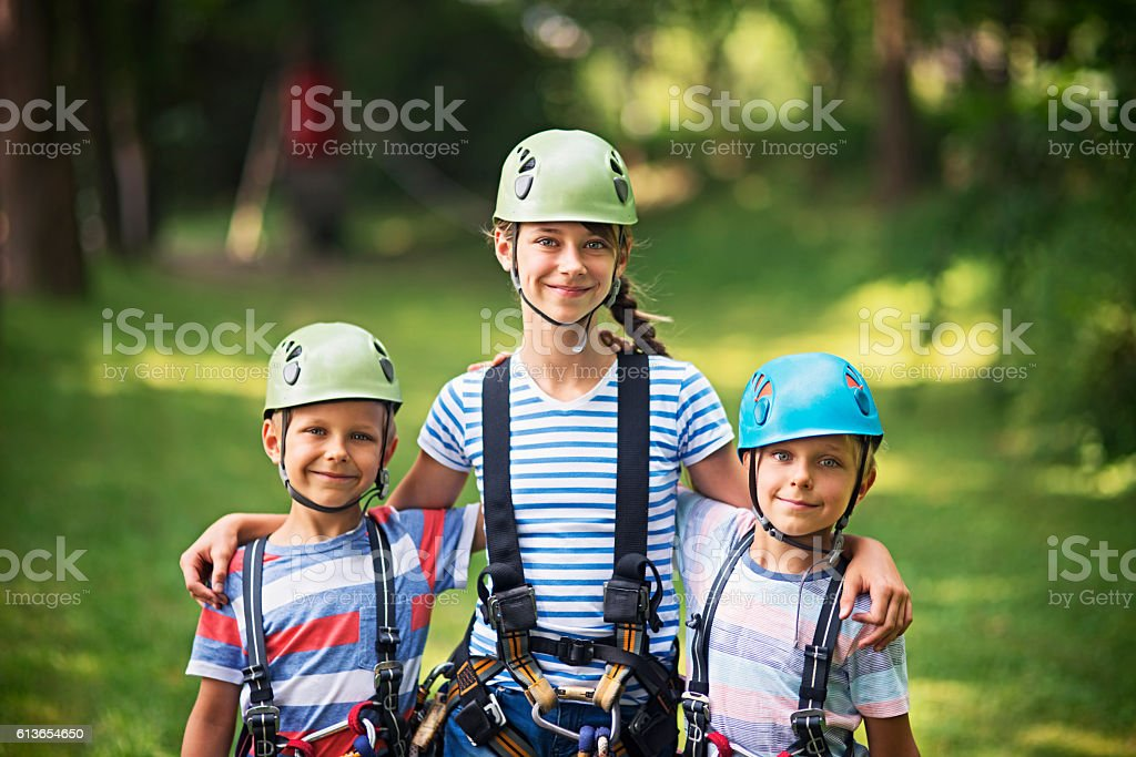Kids preparing to have fun in ropes course adventure park stock photo