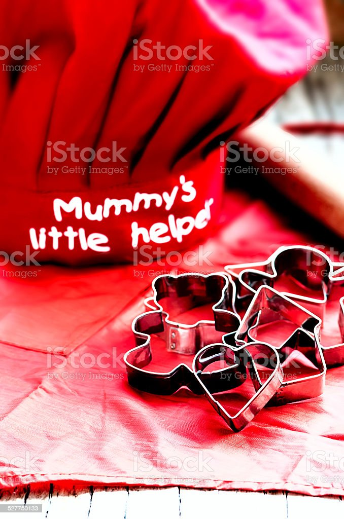 Kids red toque and apron, cookie cutters, rolling pin stock photo