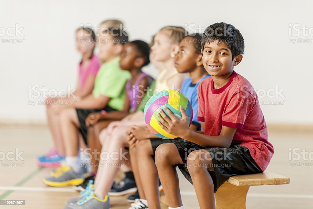 Kids resting after volleyball training royalty-free stock photo