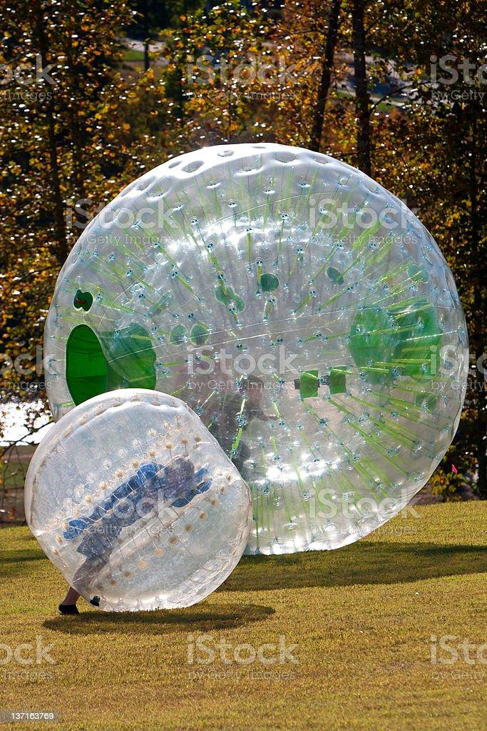 Kids Roll Inside Large Plastic Balls royalty-free stock photo