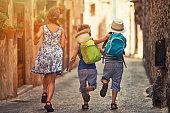 Kids running in mediterranean street.