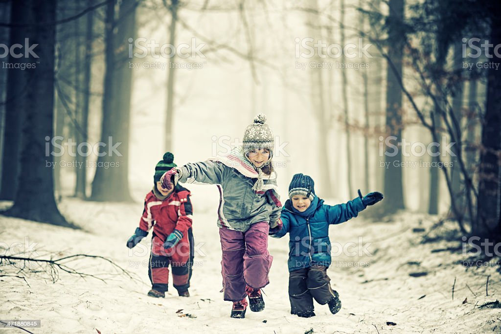 Kids running in misty forest royalty-free stock photo