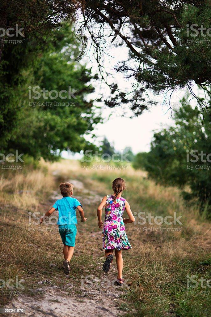 Kids running in nature stock photo