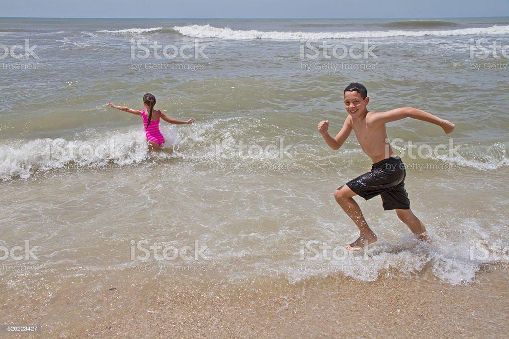 Kids Running to the sea stock photo