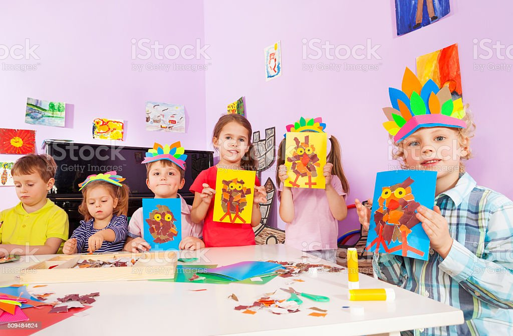 Kids show their crafts in creativity class stock photo