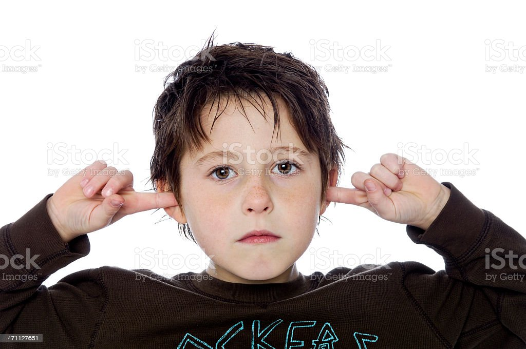 Kids - Silly little boy plugging his ears (XL) royalty-free stock photo