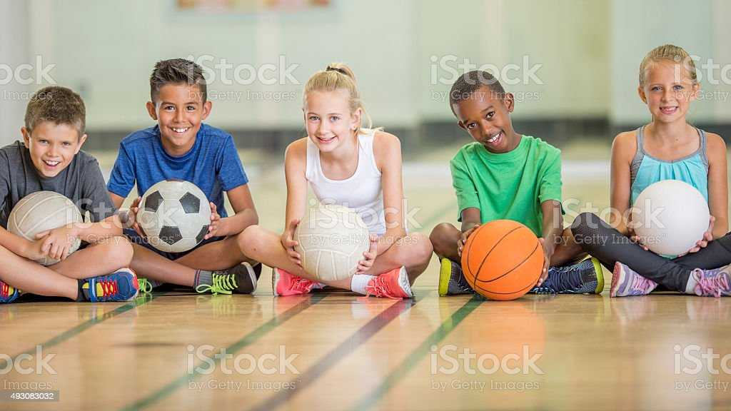 Kids Sitting at the Gym royalty-free stock photo