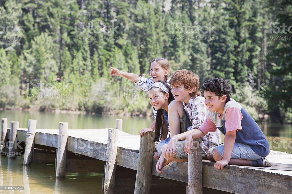 Kids sitting on dock royalty-free stock photo