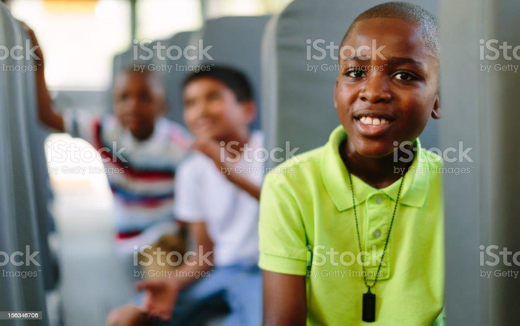 kids sitting on school bus stock photo