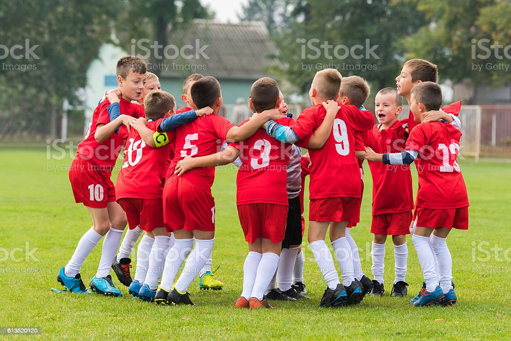 kids soccer team in huddle stock photo