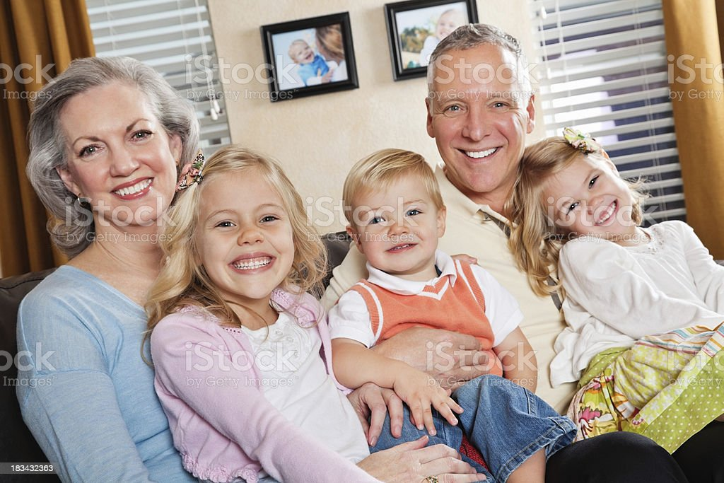Kids Spending Time With Their Grandparents in Living Room royalty-free stock photo