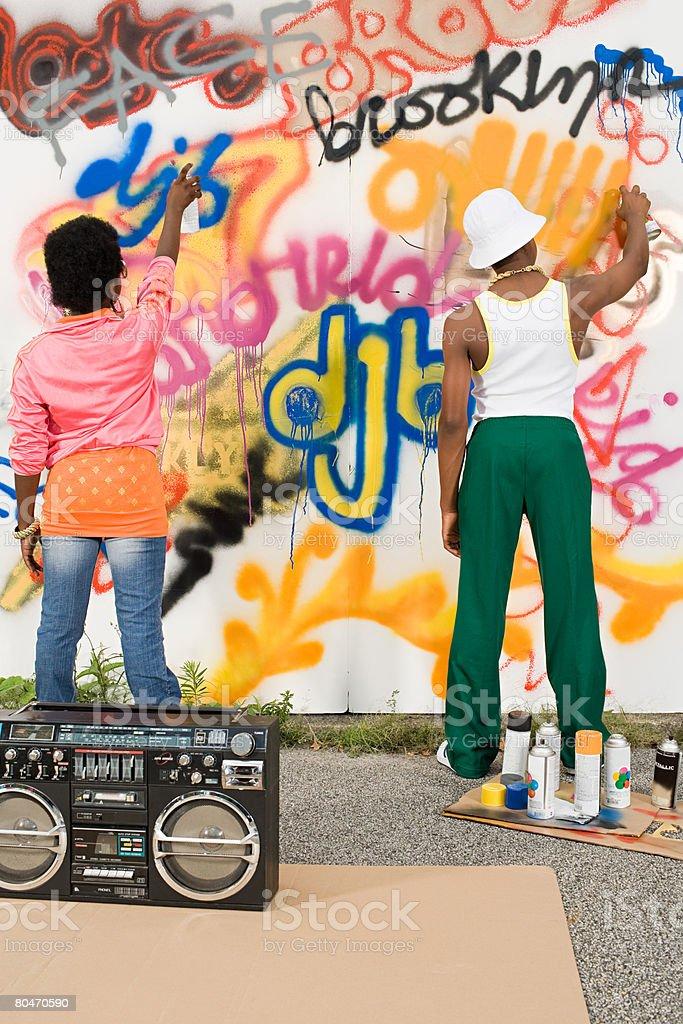 Kids spraying graffiti royalty-free stock photo