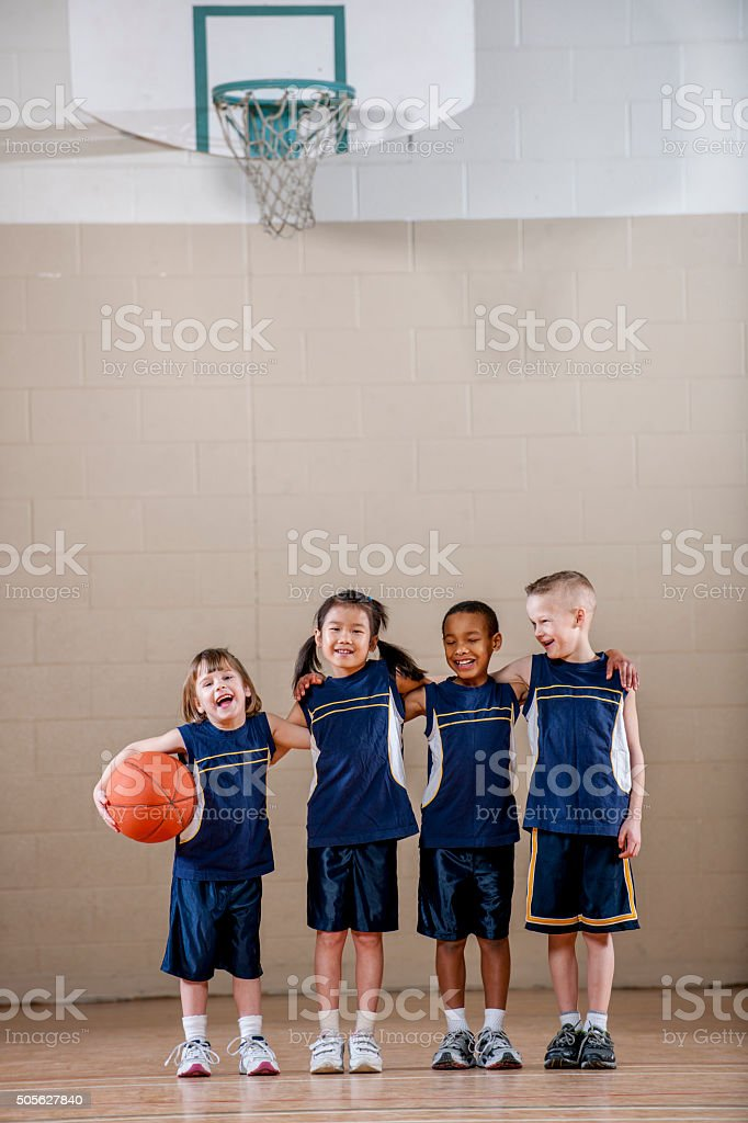 Kids Standing Together Before a Basketball Game stock photo