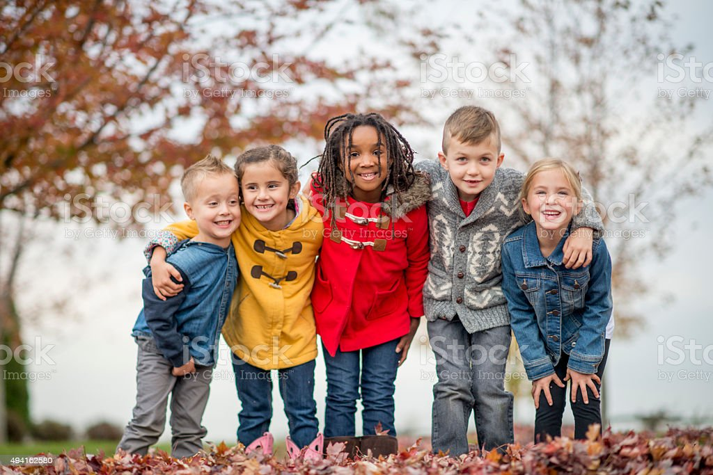 Kids Standing Together in a Row at the Park stock photo