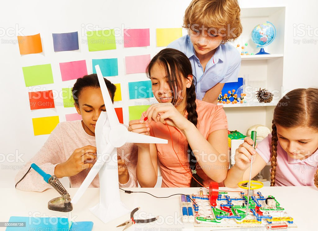 Kids studying the processes of energy transmission stock photo
