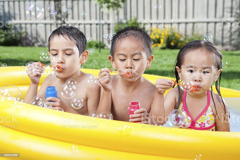 Kids swimming in wading pool stock photo