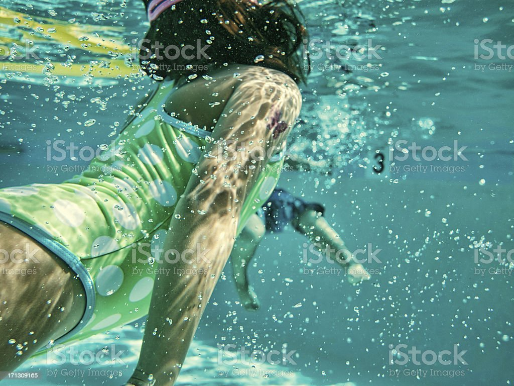 Kids Swimming Underwater kids swimming underwater stock photo 171309165 | istock