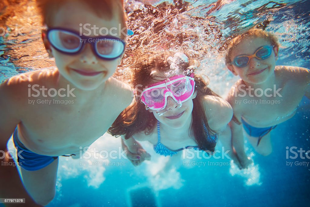 Kids swimming underwater stock photo