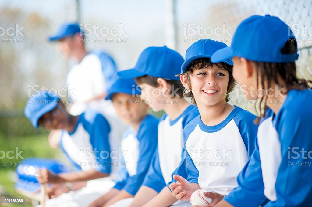 Kids Talking in the Dug Out stock photo