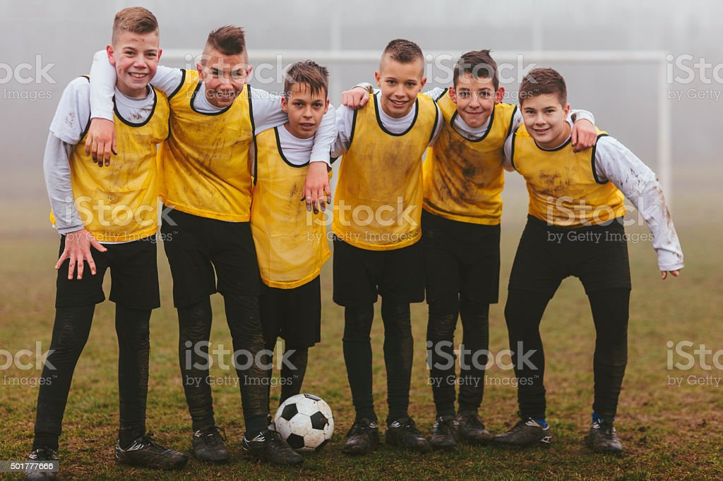 Kids Team Photo After Playing soccer. stock photo