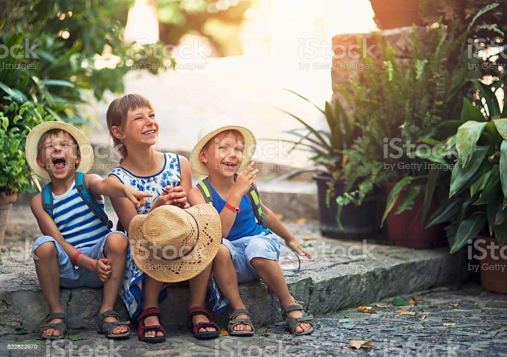 Kids tourist laughing in mediterranean street. stock photo