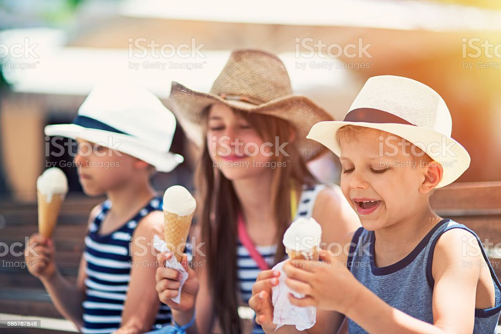Kids tourists eating ice cream stock photo