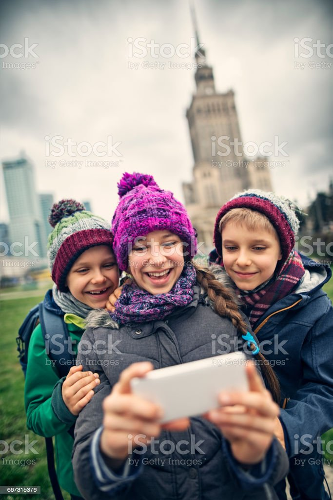 Kids tourists making selfie at Warsaw, Poland stock photo
