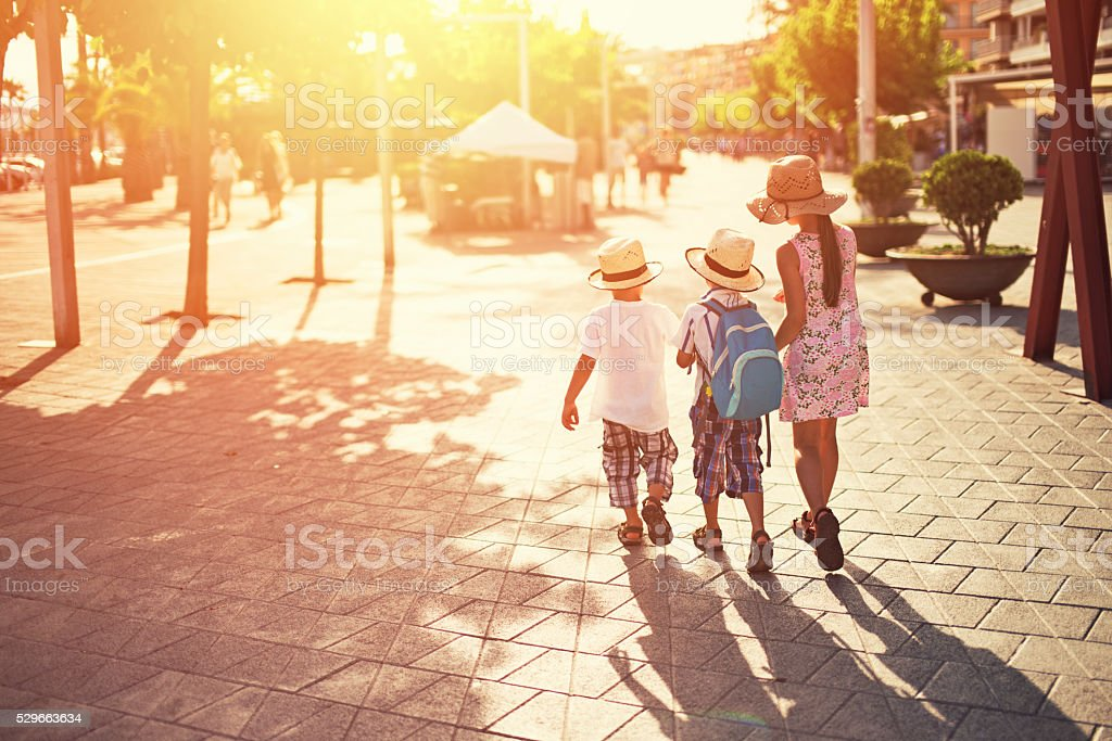 Kids tourists visiting mediterranean town. stock photo
