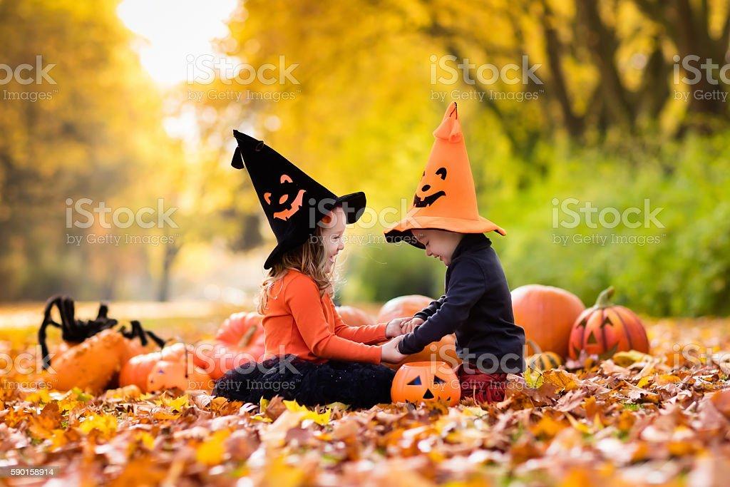 Kids trick or treat on Halloween stock photo