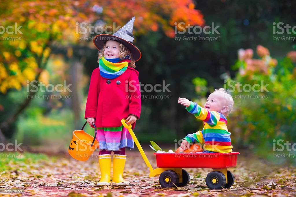 Kids trick or treating at Halloween stock photo