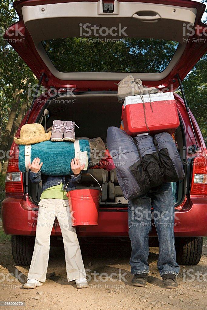 Kids unpacking car stock photo