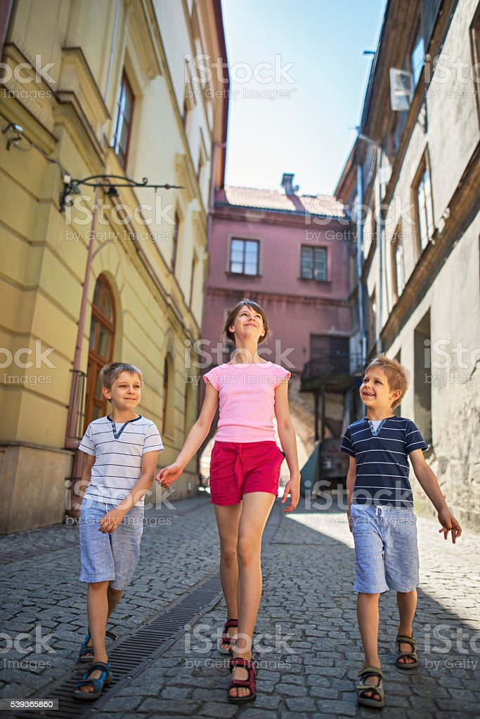 Kids visiting old town of Lublin, Poland stock photo