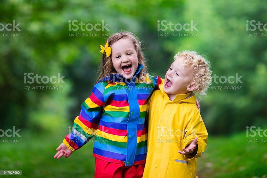 Kids walking in the rain stock photo