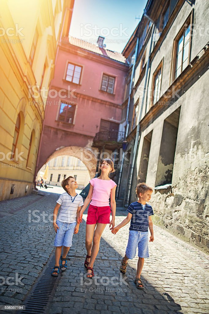 Kids walking street of old town - Lublin, Poland stock photo