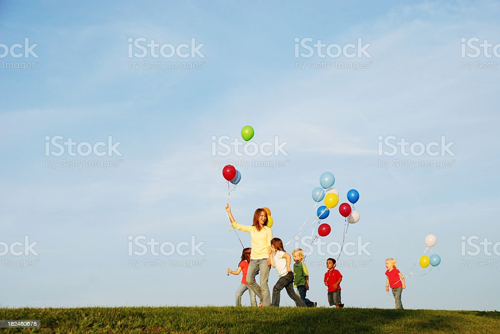 Kids Walking with Balloons royalty-free stock photo