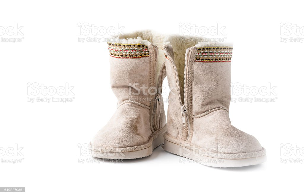 Kids warm winter boots with fur isolated stock photo