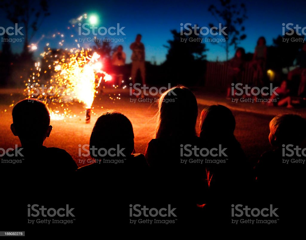 Kids Watching Fireworks: Fourth of July royalty-free stock photo