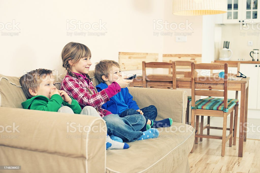 Kids watching TV royalty-free stock photo