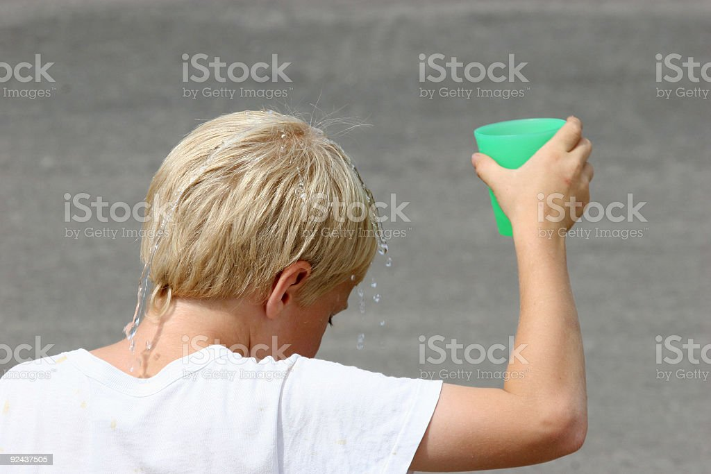 Kid's water cooling royalty-free stock photo