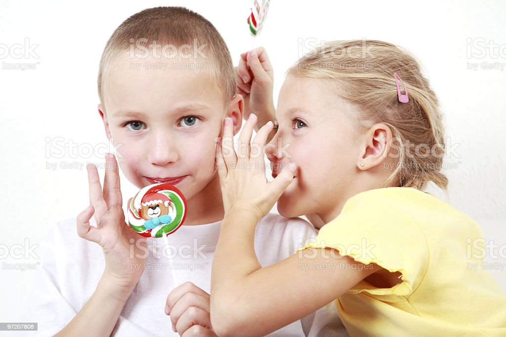 Kids whispering stock photo