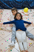 kids with confetti on the floor