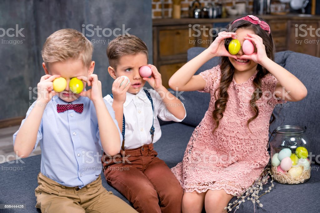 Kids with Easter eggs stock photo